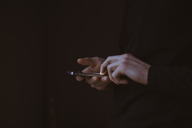 A photo of a someone's hands scrolling through their phone by Gilles Lambert on Unsplash