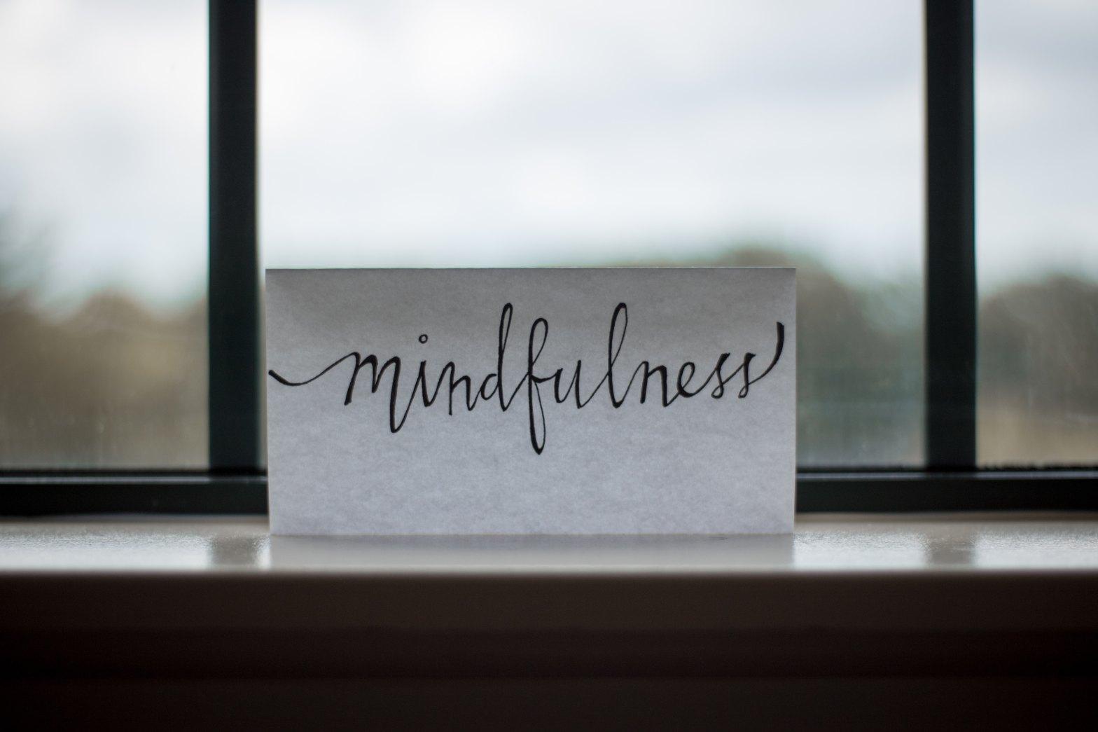 mindfulness printed paper near window
