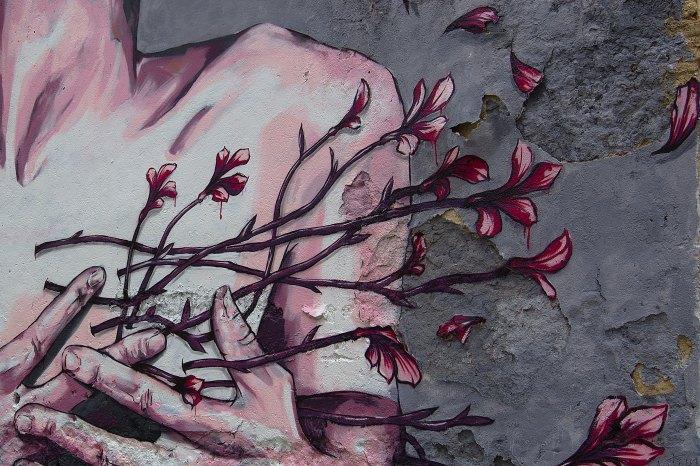 painting of roses on a body Photo by Brigitta Schneiter on Unsplash