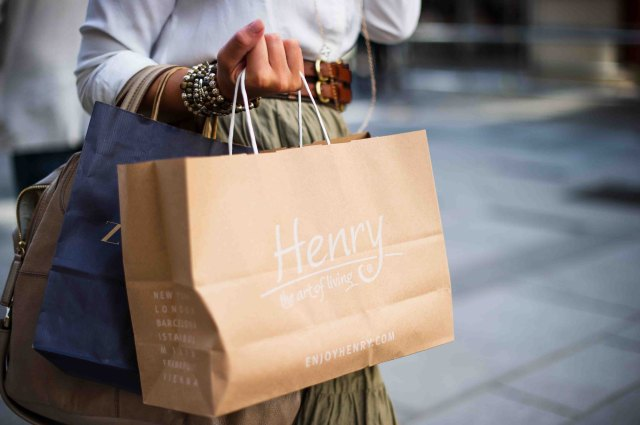 A Photo of a woman holding a shopping bag by Jacek Dylag on Unsplash