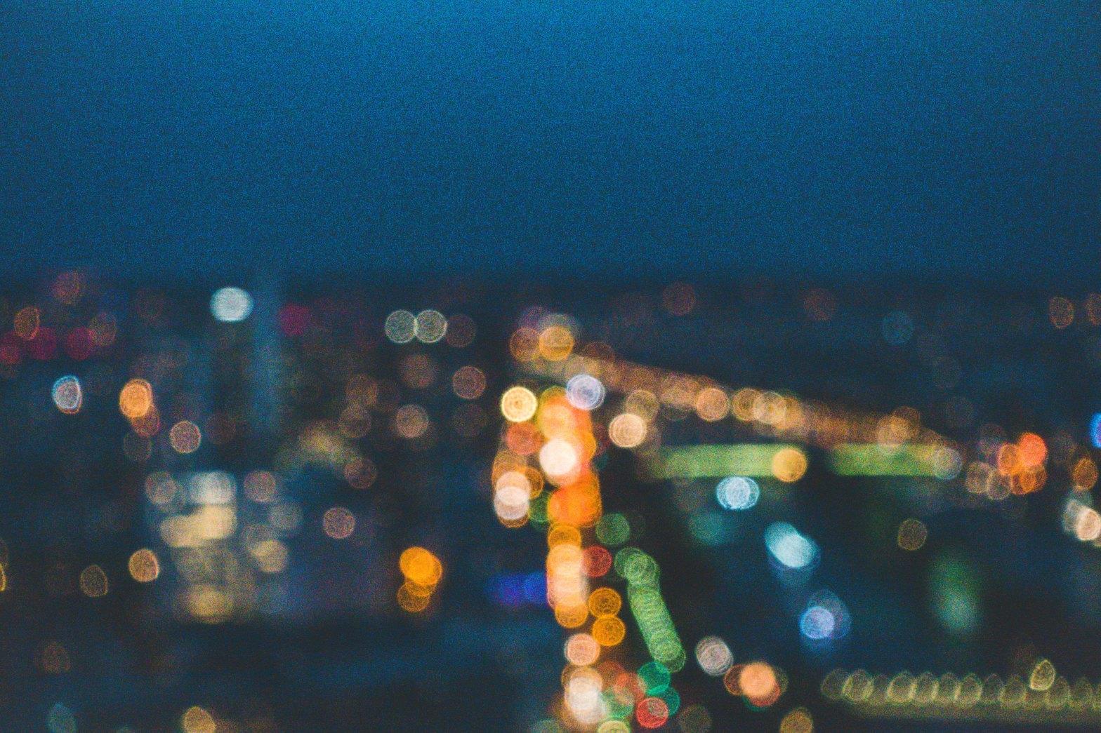 A blurred photo of city lights Photo by Sen Lin on Unsplash