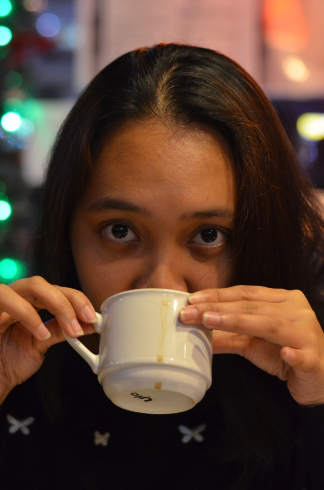 picture of a girl sipping her coffee