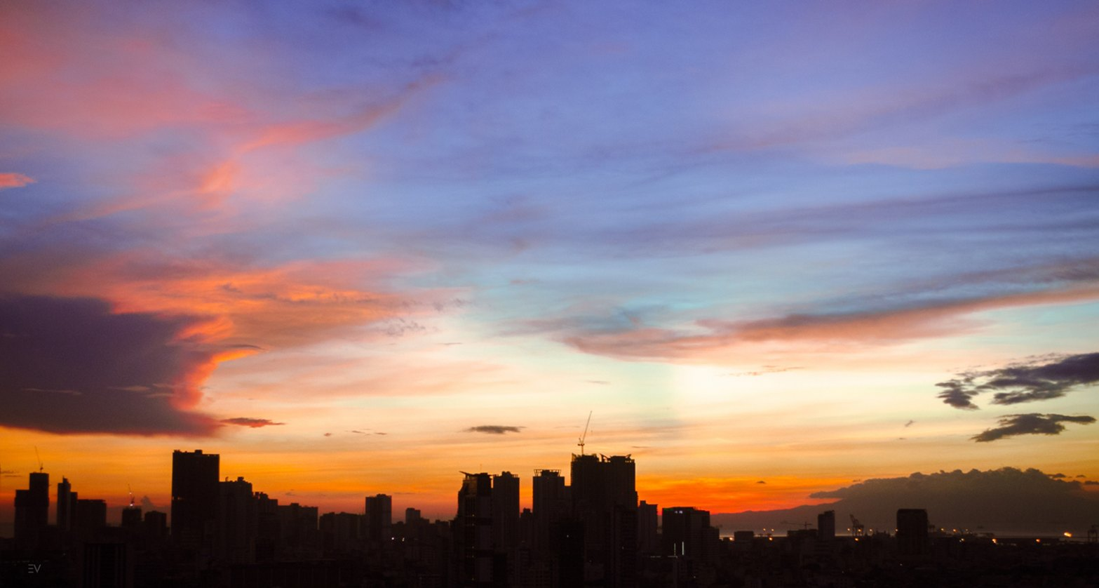 A photo of silhouette high rise buildings by Eldon Vince