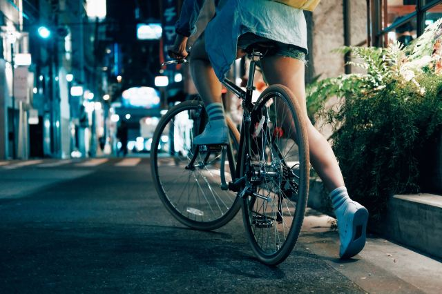A Photo of a woman on a bike by Louis Lo on Unsplash