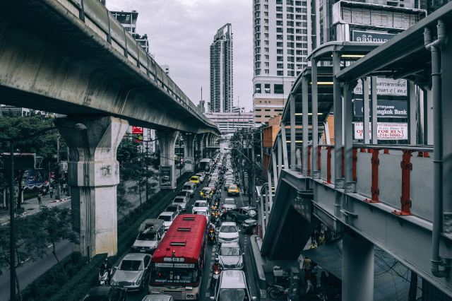 A Photo of assorted vehicle on heavy traffic below train overpass during daytime by Peter Hershey on Unsplash