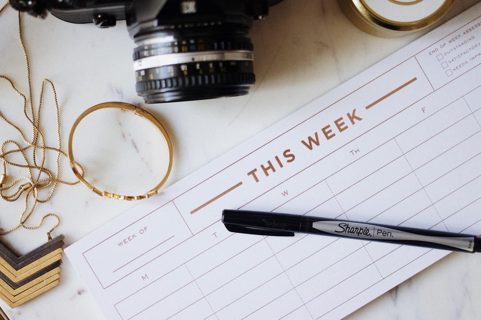 closeup photo of ballpoint pen near camera by Jazmin Quaynor via Unsplash