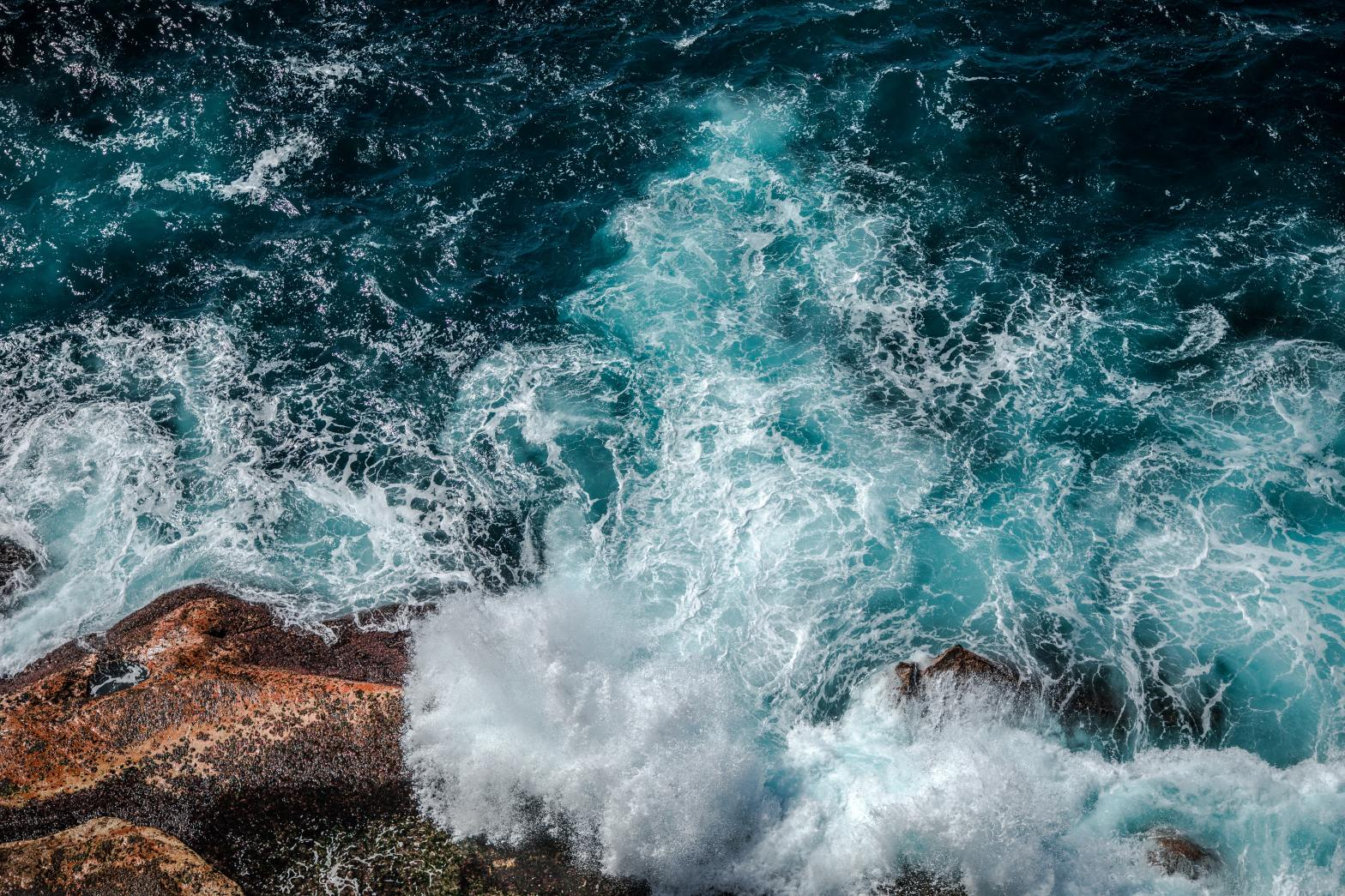 A picture of waves crashing onto the shore Photo by Jamie Davies on Unsplash